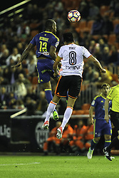 April 6, 2017 - Valencia, Comunidad Valenciana, Spain - Valencia CF vs Real Celta de Vigo - La Liga Matchday 30 - Estadio Mestalla, in action during the game -- Beauvue from Celta de Vigo (left) jumps for a high ball with Enzo Perez from Valencia CF  (Credit Image: © Vwpics/VW Pics via ZUMA Wire/ZUMAPRESS.com)