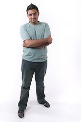 Portrait of a teenaged boy smiling,