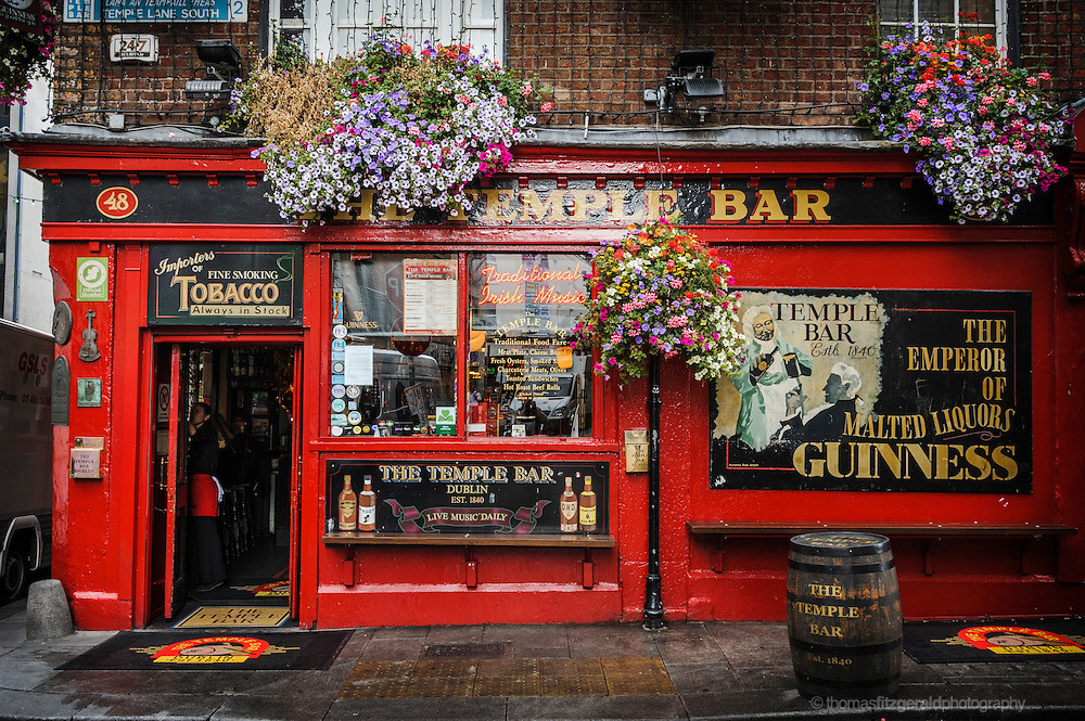 The famous Temple Bar Pub in Dublin. This famous pub with its bright red paint and numerous vintage posters is one of the most popular tourist spots in Dublin's Temple Bar District.