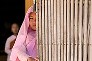 Young Nun with gate, Padonmar Sari Nunnery, Taunggyi, Myanmar