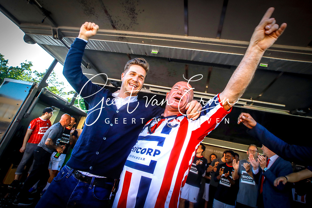 *Jordens Peters* of Willem II celebrating the season with  supporter Ben of Willem II