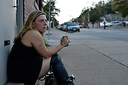 "Sherry Sams, 41, a heroin addict who has lost four children to the social service system, sits at her favorite spot, a vacant building along State Street and Dutton Avenue, where she works as a prostitute for drug money. The spot is in the crime infected Lower Price Hills neighborhood of Cincinnati, Ohio, an epicenter of a growing heroin crisis across the U.S. Sams says she has tired several drug rehab programs,  but has been unable to succeed. She says part of the problem is that heroin withdrawal is extremely painful, and so the drug becomes ""like a medication."""
