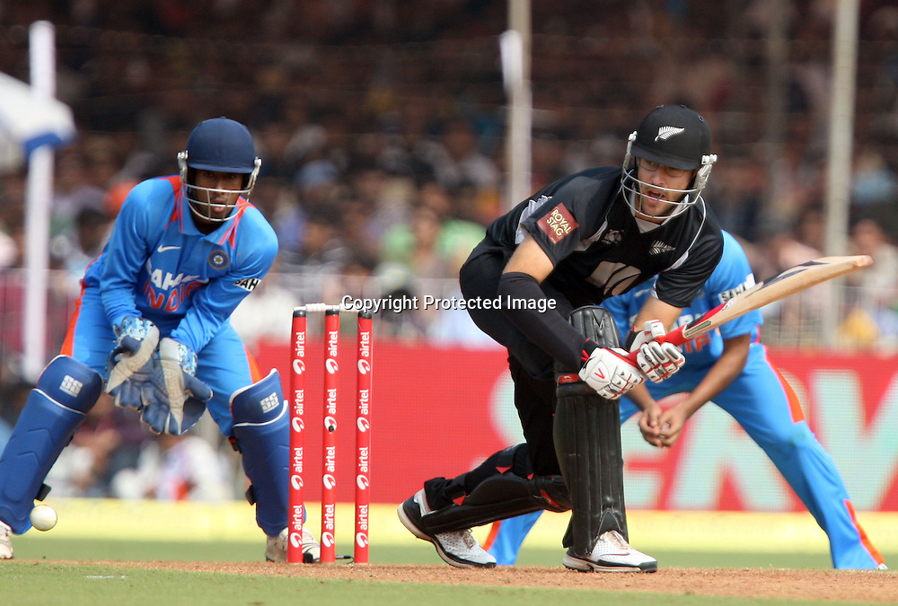New Zealand captain Daniel Vettori plays a shot against india during the tosse for 3rd ODI India vs New Zealand Played at Reliance Stadium, Vadodara, 4 December 2010 (50-over match)