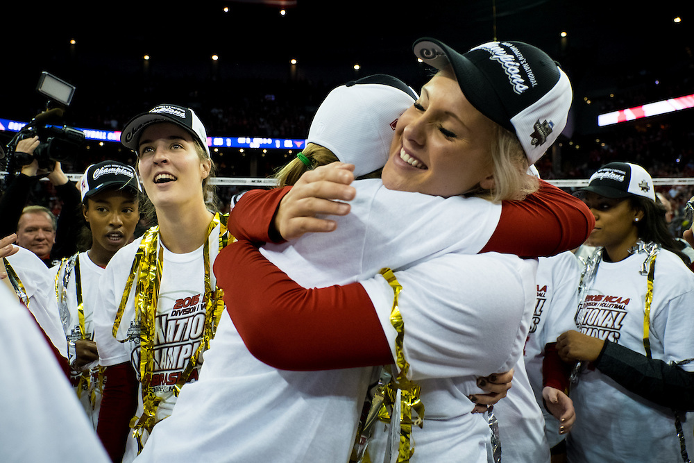 OMAHA, NE - DECEMBER 19: Outside hitter Olivia Boender #27 of the Nebraska Cornhuskers hugs a teammate after winning the NCAA finals match against the Texas at the CenturyLink Center on December 19, 2015 in Omaha, Nebraska.  (Photo by Eric Francis)