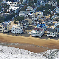 Closeup of beachfront property, Dewey Beach, DE.  Notice how the storm surge undercut these houses foundations.