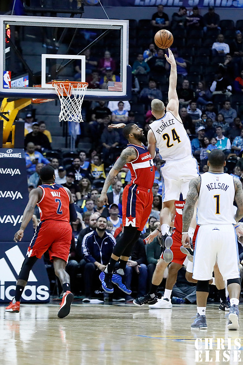 08 March 2017: Denver Nuggets center Mason Plumlee (24) goes for the skyhook against Washington Wizards forward Markieff Morris (5) during the Washington Wizards 123-113 victory over the Denver Nuggets, at the Pepsi Center, Denver, Colorado, USA.