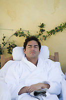 Man sleeping in bathrobe, outdoors