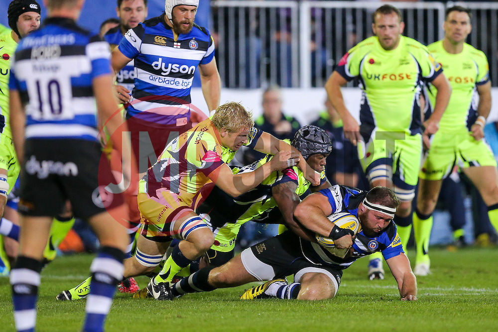 Henry Thomas of Bath Rugby is tackled by Brian Mujati and David Seymour of Sale Sharks - Rogan Thomson/JMP - 07/10/2016 - RUGBY UNION - The Recreation Ground - Bath, England - Bath Rugby v Sale Sharks - Aviva Premiership.