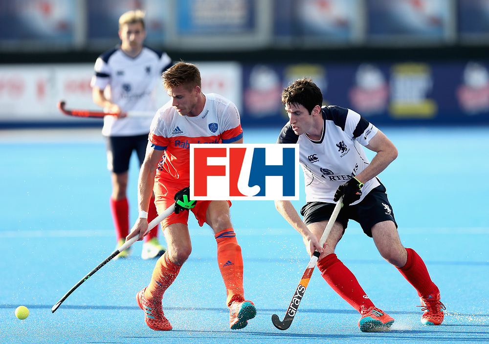 LONDON, ENGLAND - JUNE 17: Sander de Wijn of the Netherlands is challenged by Nicky Parkes of Scotland during the Hero Hockey World League Semi Final match between Scotland and Netherlands at Lee Valley Hockey and Tennis Centre on June 17, 2017 in London, England.  (Photo by Alex Morton/Getty Images)