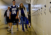 Students walk the halls of Logan High School on their way to their first class of the day.