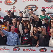 Darrell Wallace Jr #6 and his team pose for photos with the Monster mile trophy in Victory lane Friday, Sept. 30, 2011 at Dover International Speedway in Dover Delaware..