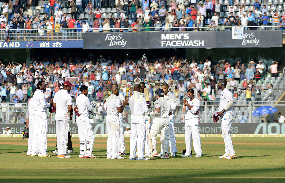 Team West Indies stand guard of honour as Sachin Tendulkar of India walks  during day one of the second Star Sports test match between India and The West Indies held at The Wankhede Stadium in Mumbai, India on the 14th November 2013<br /> <br /> This test match is the 200th test match for Sachin Tendulkar and his last for India.  After a career spanning more than 24yrs Sachin is retiring from cricket and this test match is his last appearance on the field of play.<br /> <br /> Photo by: Pal PIllai - BCCI - SPORTZPICS<br /> <br /> Use of this image is subject to the terms and conditions as outlined by the BCCI. These terms can be found by following this link:<br /> <br /> http://sportzpics.photoshelter.com/gallery/BCCI-Image-Terms/G0000ahUVIIEBQ84/C0000whs75.ajndY
