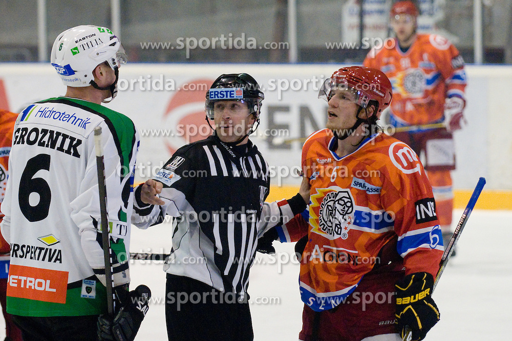 Bostjan Groznik (HDD Tilia Olimpija, #6) vs Toni Dahlman (HK Acroni Jesenice, #6) during ice-hockey match between HK Acroni Jesenice and HDD Tilia Olimpija in 33rd Round of EBEL league, on Januar 1, 2011 at Dvorana Podmezaklja, Jesenice, Slovenia. (Photo By Matic Klansek Velej / Sportida.com)
