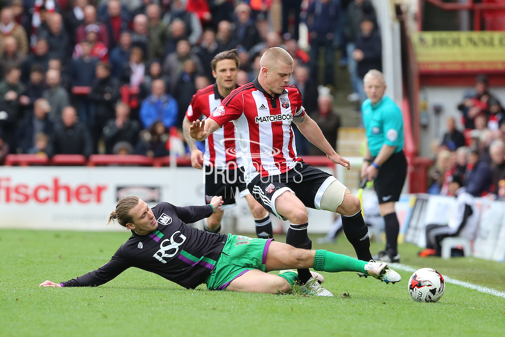 Bristol City striker, Luke Freeman (15) tackling Brentford defender, Jake Bidwell (3) during the Sky Bet Championship match between Brentford and Bristol City at Griffin Park, London, England on 16 April 2016. Photo by Matthew Redman.