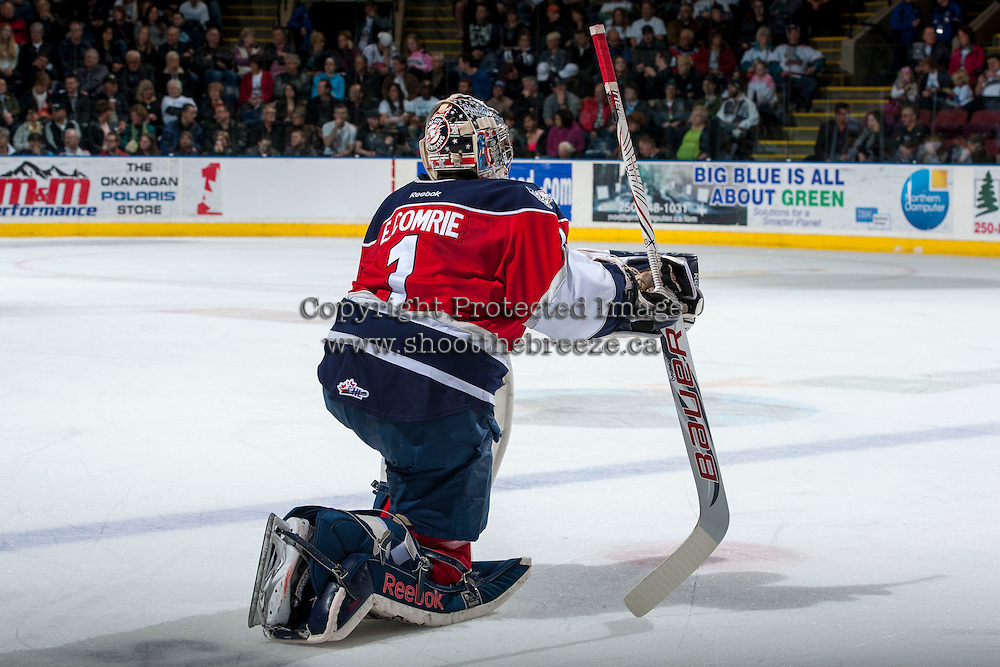KELOWNA, CANADA - MARCH 28: Eric Comrie #1 of the Tri-City Americans stands on the ice during a time out against the Kelowna Rockets during game 5 of the first round of WHL playoffs on March 28, 2014 at Prospera Place in Kelowna, British Columbia, Canada.   (Photo by Marissa Baecker/Shoot the Breeze)  *** Local Caption *** Eric Comrie;