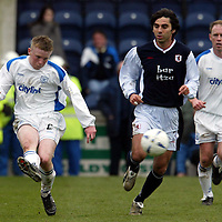Raith Rovers v St Johnstone...10.04.04<br />Mark Baxter clears from Goran Stanic<br /><br />Picture by Graeme Hart.<br />Copyright Perthshire Picture Agency<br />Tel: 01738 623350  Mobile: 07990 594431