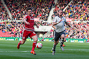 Middlesbrough FC striker David Nugent runs towards goal shadowed by Fulham defender Richard Stearman during the Sky Bet Championship match between Middlesbrough and Fulham at the Riverside Stadium, Middlesbrough, England on 17 October 2015. Photo by George Ledger.