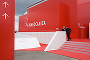 Delegates outside Italian aerospace and defence Finmeccanica's trade stand at the Farnborough Air Show, UK.