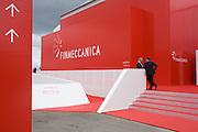 Delegates outside Italian aerospace and defence Finmeccanica's trade stand at the Farnborough Air Show, UK.