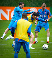 NETHERLANDS, HOENDERLOO : Dutch international football player Rafael van der Vaart  (l) duel with Klaas Jan Huntelaar and Dirk Kuyt (back) at the trainingcamp of the Netherlands national football team in Hoenderloo on May 31, 2012. AFP PHOTO/ ROBIN UTRECHT