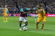 Michail Antonio of West Ham United and Gaetan Bong of Brighton & Hove Albion during the Premier League match between West Ham United and Brighton and Hove Albion at the London Stadium, London, England on 20 October 2017. Photo by Toyin Oshodi.