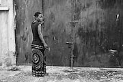 Zanzibar Town, Zanzibar -   2015-03-25  - Hadidja at the gate of the Malaika Sober House for women in Zanzibar Town, Zanzibar on March 25, 2015. Weeks later, Hadidja was found dead and visibly beaten; police ruled the death an overdose.   Photo by Daniel Hayduk