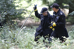 © Licensed to London News Pictures. 13/05/2020. Alice Holt Woods, UK. A Hampshire police search team scour Alice Holt Woods in Hampshire after British Diplomat Richard Morris went missing seven days ago. Mr Morris was last seen leaving his home in nearby Bentley to go for a run on May 6, 2020. Police are appealing for local residents to search their gardens and out buildings as concern grows. Photo credit: Peter Macdiarmid/LNP