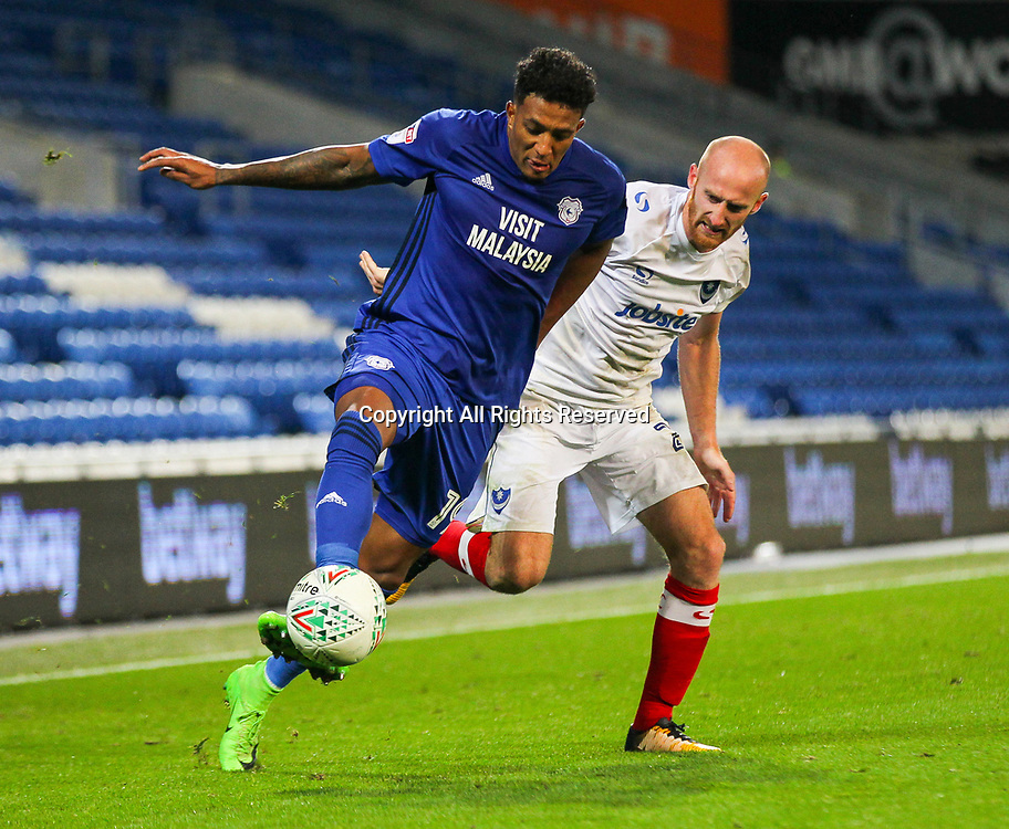 August 8th 2017, Cardiff City Stadium, Cardiff, Wales; Carabao Cup First Round; Cardiff City versus Portsmouth; Nathaniel Mendez-Laing (L) of Cardiff City dribbles past Drew Talbot (R) of Portsmouth