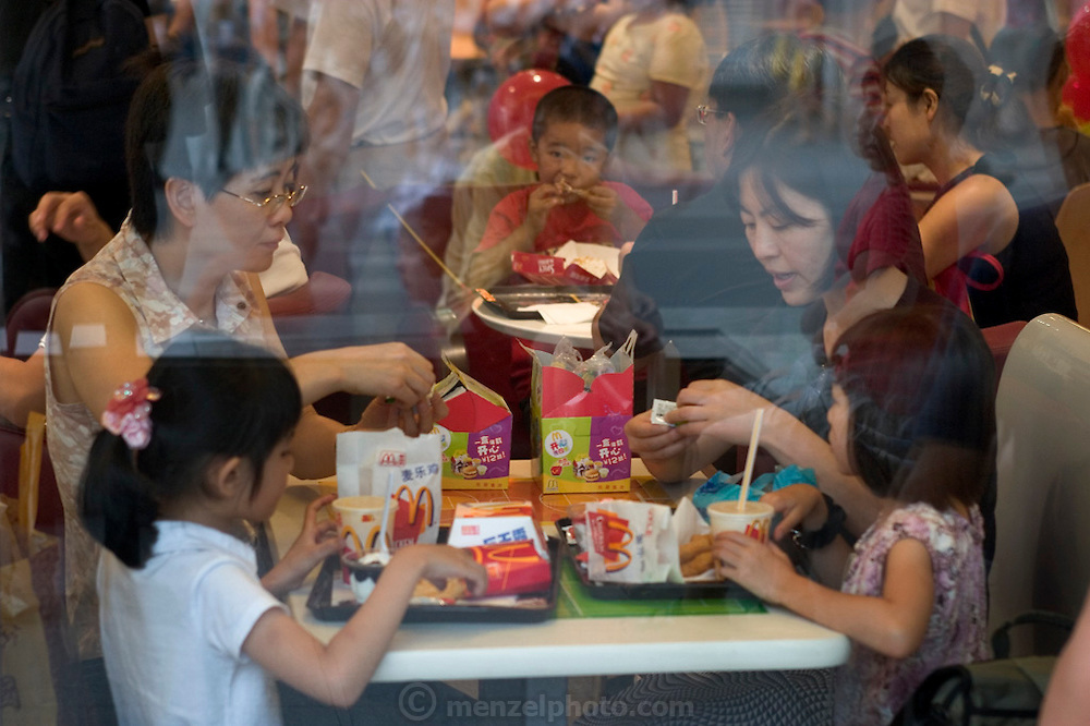 McDonald's restaurant, Beijing, China. (Supporting image from the project Hungry Planet: What the World Eats.) Fast Food. Has any human invention ever been as loved and loathed as fast food? Feelings run deep about the huge U.S. fast-food chains, especially McDonald's and KFC. Internationally recognized as symbols of Americanization, globalization, and overflowing schedules, they are also symbols of convenience, reliability, and (usually) cleanliness.