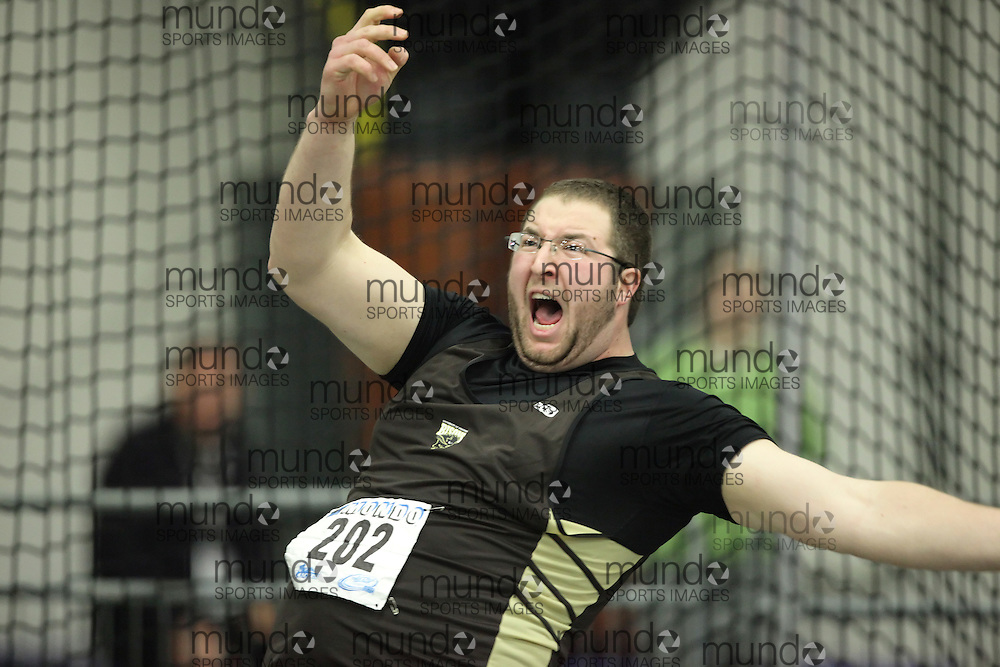 (Windsor, Ontario---12 March 2010) Justin Charrier of University of Manitoba   competes in the  at the 2010 Canadian Interuniversity Sport Track and Field Championships at the St. Denis Center. Photograph copyright Geoff Robins/Mundo Sport Images. www.mundosportimages.com