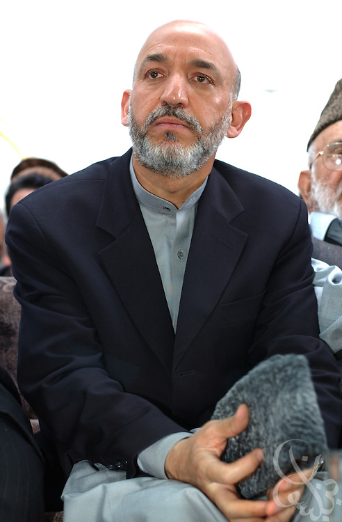 Interim Afghan leader Hamid Karzai meets with a group of tribal elders May 04, 2002 after arriving in the southern Afghan city of Kandahar. The visit by Karzai to the city, his first since assuming power, is significant because of the city's history as a former Taliban stronghold.