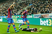 Luka Milivojevic (#4) of Crystal Palace fouls Sean Longstaff (#36) of Newcastle United during the Premier League match between Newcastle United and Crystal Palace at St. James's Park, Newcastle, England on 21 December 2019.