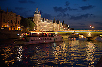 boats on the River Seine, Paris, approaching the Napoleon Bridge, with the conciergerie on Ile de la Cite on the left.