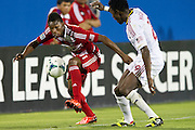 FRISCO, TX - JULY 13:  Fabian Castillo #11 of FC Dallas controls the ball while defended by Abdoulie Mansally #29 of Real Salt Lake on July 13, 2013 at FC Dallas Stadium in Frisco, Texas.  (Photo by Cooper Neill/Getty Images) *** Local Caption *** Fabian Castillo; Abdoulie Mansally