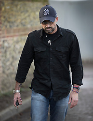 © Licensed to London News Pictures. 26/12/2016. Goring-, UK. Mark Elvidge 53, a fan of George Michael, who looks like his idol, walks from his house in Goring. Pop superstar George Michael died on Christmas day at his Oxfordshire home on the River Thames aged 53. Photo credit: Peter Macdiarmid/LNP