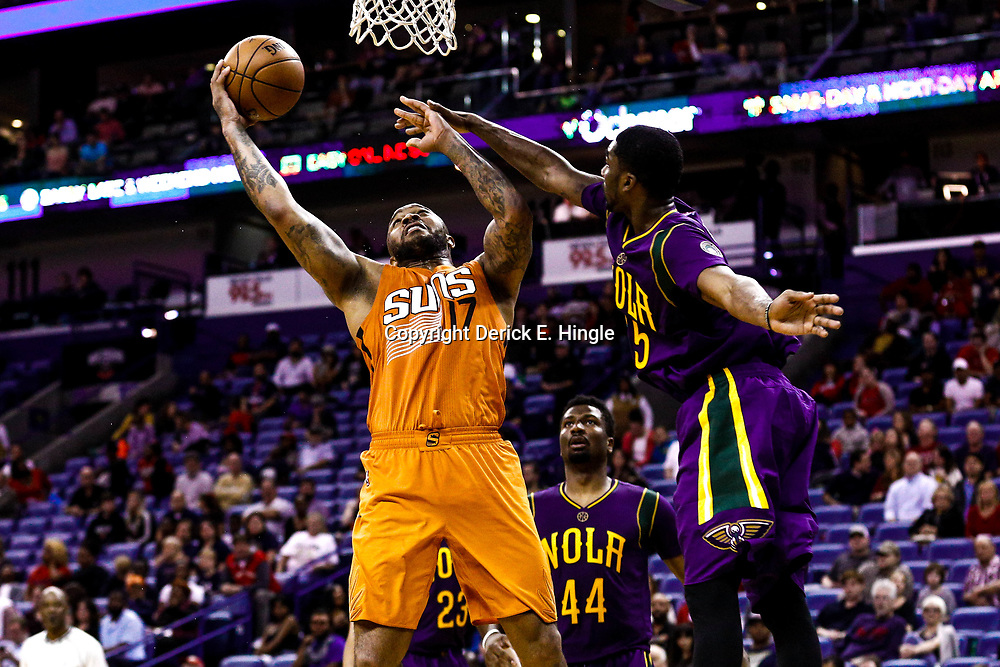 Feb 6, 2017; New Orleans, LA, USA; Phoenix Suns forward P.J. Tucker (17) shoots over New Orleans Pelicans guard E'Twaun Moore (55) during the second half of a game at the Smoothie King Center. The Pelicans defeated the Suns 111-106. Mandatory Credit: Derick E. Hingle-USA TODAY Sports