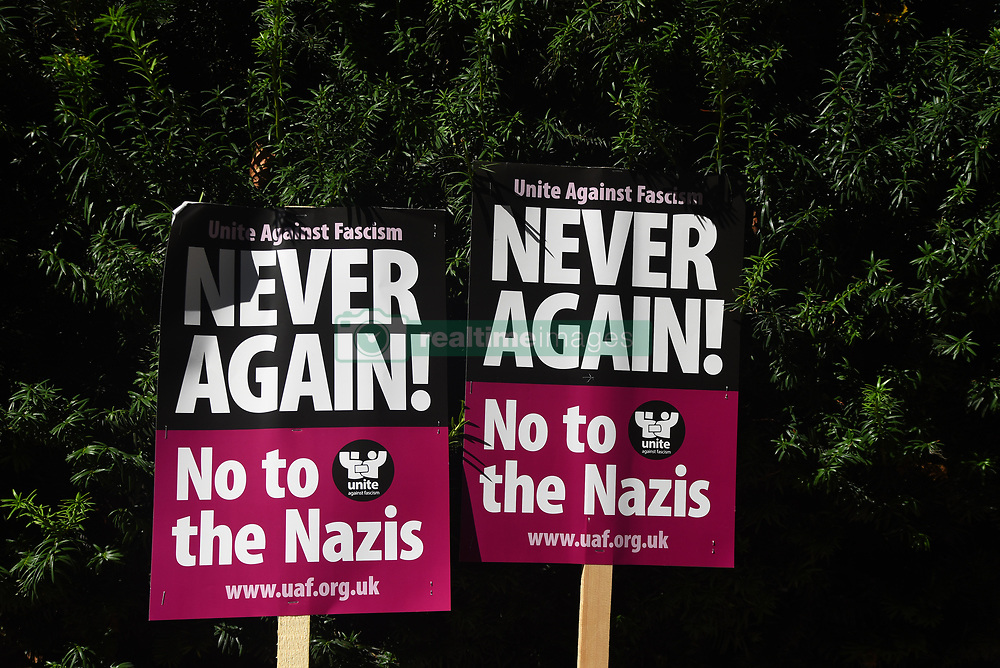 August 19, 2017 - London, England, United Kingdom - Two placards are seen outside the American Embassy in Central London, at the protest against the racism escalation following the riot in Charlottesville, London on August 19, 2017. In Charlottesville, Virginia, took place the most violent clashes at the largest gathering of white nationalists in America for decades. President Donald Trump has been criticized for his reaction, considered too soft. (Credit Image: © Alberto Pezzali/NurPhoto via ZUMA Press)