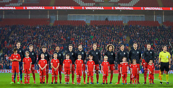 CARDIFF, WALES - Tuesday, November 14, 2017: Wales players and mascots line-up before the international friendly match between Wales and Panama at the Cardiff City Stadium. Goalkeeper Daniel Ward, David Brooks, Ben Woodburn, Neil Taylor, Tom Lawrence, Ben Davies, David Edwards, Ethan Ampadu, James Chester, Sam Vokes, captain Chris Gunter. (Pic by David Rawcliffe/Propaganda)