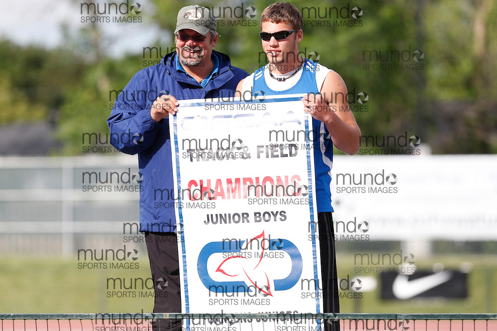 Noah Rolph and his coach/father Kyle celebrate Parkside's Junior Boys team championship at the 2013 OFSAA Track and Field Championship in Oshawa Ontario, Sunday,  June 9, 2013.<br /> Mundo Sport Images/ Geoff Robins