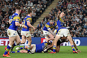 Leeds Rhinos second row forward Brett Delaney (15) points as a Hull FC player is halted by the Leeds Rhinos defence during the Betfred Super League match between Hull FC and Leeds Rhinos at Kingston Communications Stadium, Hull, United Kingdom on 19 April 2018. Picture by Mick Atkins.