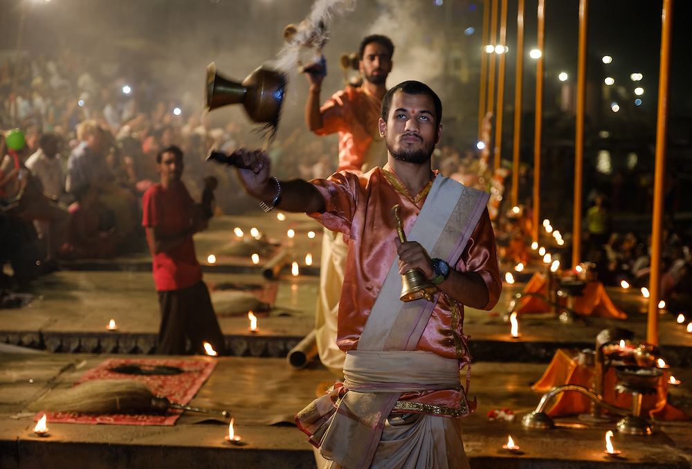 VARANASI, INDIA - CIRCA NOVEMBER 2016:  Young pandits performing the Ganga Aarti ceremony at the  Dasaswamedh Ghat in Varanasi. The Aarti is a powerful and uplifting spiritual ritual that takes place every evening at dusk. Varanasi is the spiritual capital of India, the holiest of the seven sacred cities and with that many rituals and offerings are performed daily by priests and hindus.