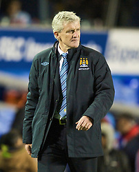 BIRMINGHAM, ENGLAND - Sunday, November 1, 2009: Manchester City's manager Mark Hughes walks off after his side's goalless draw with Birmingham City during the Premiership match at St Andrews. (Pic by David Rawcliffe/Propaganda)