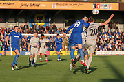 AFC Wimbledon striker Joe Pigott (39) battles for possession with Portsmouth defender Sean Raggett (20) during the EFL Sky Bet League 1 match between AFC Wimbledon and Portsmouth at the Cherry Red Records Stadium, Kingston, England on 19 October 2019.