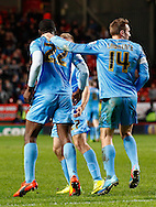 Jean-Yves Mvoto (left) of Barnsley celebrates scoring the opening goal with Liam Lawrence of Barnsley (right) during the Sky Bet Championship match at The Valley, London<br /> Picture by David Horn/Focus Images Ltd +44 7545 970036<br /> 15/04/2014