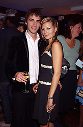 MR PHILIPPE KCIOT and MISS JESSICA SIMON at a party to view the designs of Jessica Simon at the beginning of London Fashion Week held at The Electric Cinema, Portabello Road, London on 19th September 2004.<br />