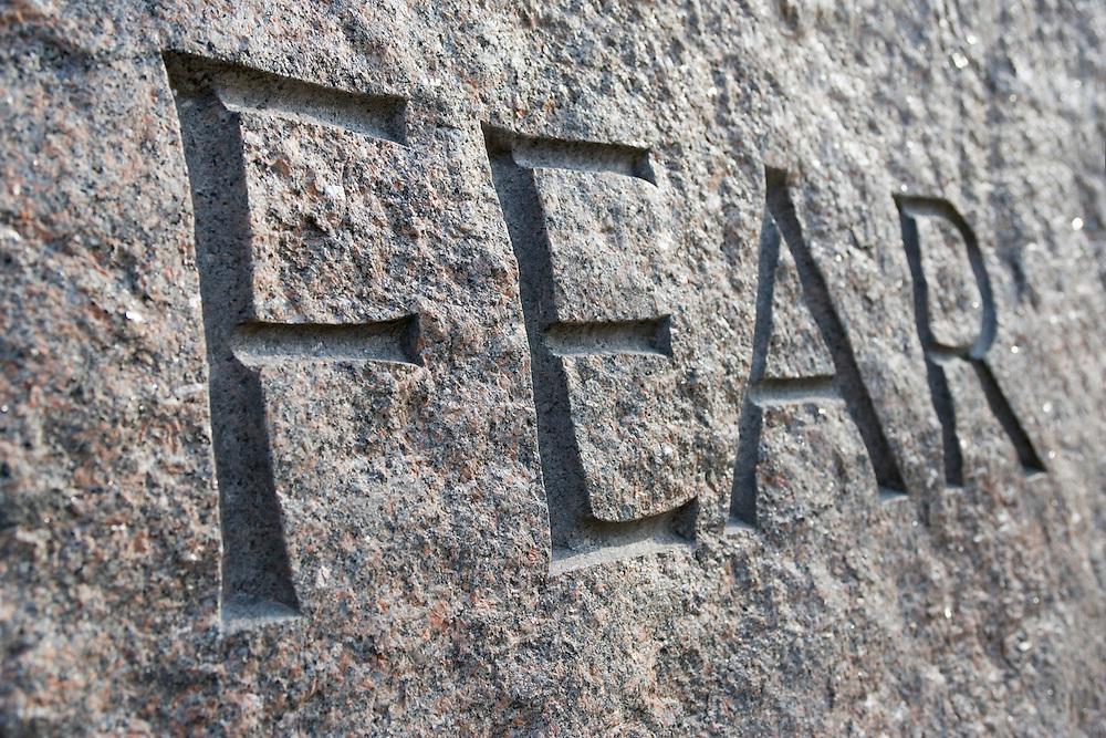 The word Fear engraved on FDR Memorial Washington DC USA&#xA;<br />