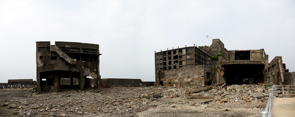 """NAGASAKI, JAPAN - AUGUST 8: Panoramic view inside of Hashima Island, commonly known as Gunkanjima or """"Battleship Island"""" in Nagasaki Prefecture, southern Japan on August 8, 2017. The island was a coal mining facility until its closure in 1974 is a symbol of the rapid industrialization of Japan, a reminder of its dark history as a site of forced labor during the Second World War. The island now is recognized as UNESCO's World Heritage sites of Japan's Meiji Industrial Revolution. (Photo: Richard Atrero de Guzman/NURPhoto)"""