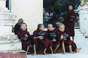 monks waiting for food in Myin Ka Bar, Bagan, Myanmar, Asia