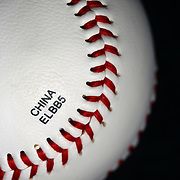 A synthetic Leather Cover recreational use baseball with a stamp showing it was made in China. The ball produced by  Rawlings was bought from Walmart, a major US store chain. Photo Tim Clayton