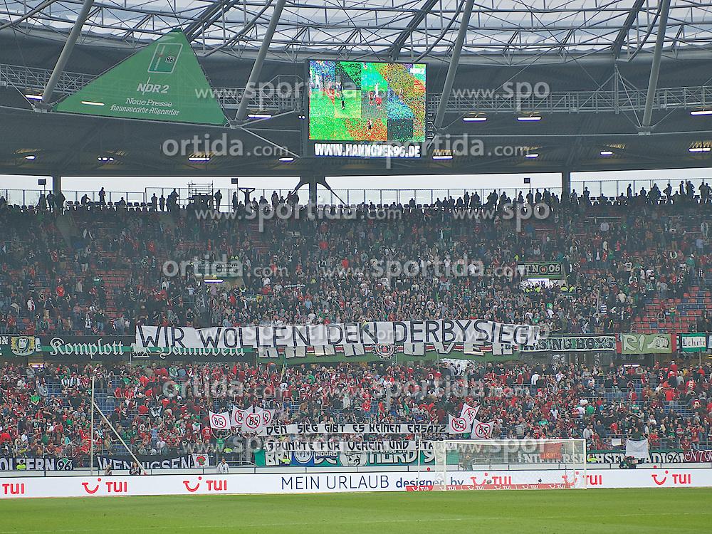 30.03.2014, AWD Arena, Hannover, GER, 1. FBL, Hannover 96 vs SV Werder Bremen, 28. Runde, im Bild in der Hannoveraner Fankurve haengt ein Banner mit der Aufschrift &quot;Wir wollen den Derbysieg&quot; // in der Hannoveraner Fankurve haengt ein Banner mit der Aufschrift &quot;Wir wollen den Derbysieg&quot; during the German Bundesliga 28th round match between Hannover 96 and SV Werder Bremen at the AWD Arena in Hannover, Germany on 2014/03/30. EXPA Pictures &copy; 2014, PhotoCredit: EXPA/ Andreas Gumz<br /> <br /> *****ATTENTION - OUT of GER*****